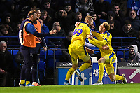 Joe Pigott of AFC Wimbledon left celebrates scoring the equaliser  with Mitch Pinnock of AFC Wimbledon to make the score 1-1 during Portsmouth vs AFC Wimbledon, Sky Bet EFL League 1 Football at Fratton Park on 11th January 2020