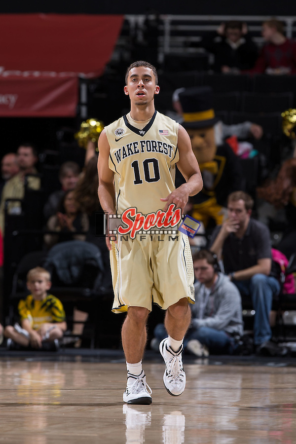 Mitchell Wilbekin (10) of the Wake Forest Demon Deacons on defense during first half action against the UNC Asheville Bulldogs at the LJVM Coliseum on November 14, 2014 in Winston-Salem, North Carolina.  The Demon Deacons defeated the Bulldogs 80-69  (Brian Westerholt/Sports On Film)