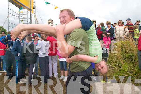 Competitors Aishling O'Sullivan from Sneem and Robbie O'Leary from Tipperary taking part in the All Ireland Wife Carrying Championships at Sneem Family Festival