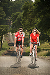 Bicycle riding along a country road in Amador County, California...Jared & Samantha Saldate and Jessie Larson..Model Released