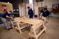"""JAMISON, PA -  NOVEMBER 1: From left, Derek Cornell, 16, Nick Ligato, 16, and Anthony Vaccaro, 22 hammer nails into boards at Middle Bucks Institute of Technology November 1, 2013 in Jamison, Pennsylvania. MBIT hosted an event for students called """"SkillsUSA Scare Crow Coin War and MBIT Exploration."""" The event is a fundraiser for SkillsUSA in which the proceeds are generally donated to a charity.(Photo by William Thomas Cain/Cain Images)"""
