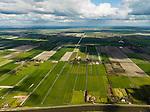 Nederland, Noord-Holland, Beemster, 16-04-2012;  De Beemster, 400 jaar 1612 - 2012. Overzicht van de Boven polder in NNO richting, rechts aan de horizon Middenbeemster. In de voorgrond Het Noordhollandsch kanaal (tevens Beemsterrringvaart). De 17e eeuwse droogmakerij, met haar  beroemde geometrische verkaveling, maakt deel uit van het wereld erfgoed (Unesco werelderfgoedlijst).The famous geometrical well-ordered polder Beemster, 17th century  reclaimed landscape, Unesco world heritage..luchtfoto (toeslag), aerial photo (additional fee required);.copyright foto/photo Siebe Swart