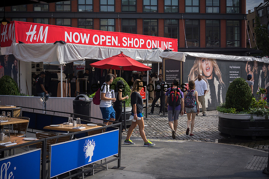 """H&M promotes online shopping and previews its """"Paris Show Collection"""" line of women's clothing with a pop-up store in the Meatpacking District in New York on Thursday, August 22, 2013.   (© Richard B. Levine)"""