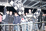 Waving: Waving their flags to the crowds that gathered in Ardfert on Sunday evening to welcome home the victorious Ardfert Team, l-r: Nick Sullivan, Sean Dineen, Seanie Griffin and John Dowling..