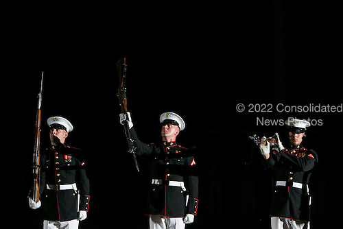 The Marine Corps Silent Drill Platoon performs during The Marine Barracks Washington, D.C. Evening Parade in Washington, D.C., on Friday, June 27, 2014. <br /> Credit: Kristoffer Tripplaar  / Pool via CNP