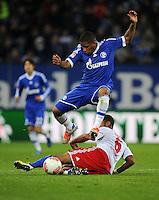 FUSSBALL   1. BUNDESLIGA    SAISON 2012/2013    14. Spieltag   Hamburger SV - FC Schalke 04                               27.11.2012 Dennis Aogo (Hamburger SV, am Boden) gegen Jefferson Farfan (FC Schalke 04)