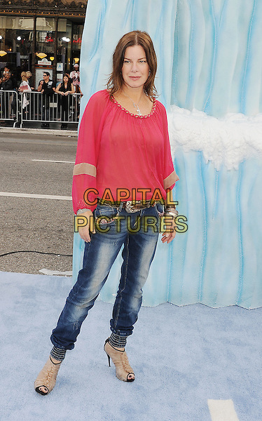 Marcia Gay Harden.The World Premiere of 'Happy Feet Two' held at The Grauman's Chinese Theatre in Hollywood, California, USA..November 13th, 2011.full length pink top  jeans denim peep toe beige shoes ankle boots .CAP/ROT/TM.©Tony Michaels/Roth Stock/Capital Pictures