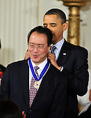 """United States President Barack Obama and first lady Michelle Obama present the 2010 Medal of Freedom, """"the Nation's highest civilian honor presented to individuals who have made especially meritorious contributions to the security or national interests of the United States, to world peace, or to cultural or other significant public or private endeavors"""", to cellist Yo-Yo Ma in a ceremony in the East Room of the White House in Washington, D.C. on Tuesday, February 15, 2011. .Credit: Ron Sachs / CNP"""