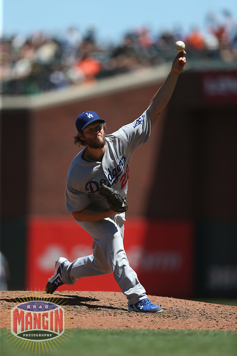 SAN FRANCISCO, CA - MAY 17:  Clayton Kershaw #22 of the Los Angeles Dodgers pitches against the San Francisco Giants during the game at AT&T Park on Wednesday, May 17, 2017 in San Francisco, California. (Photo by Brad Mangin)