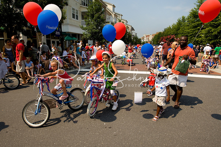 Kids and families line up to participate in the annual Fourth of July Celebration and community parade in Birkdale Village in Huntersville, NC. Birkdale Village combines the best of shopping, dining, apartments and entertainment venues within a 52-acre mixed-use development.