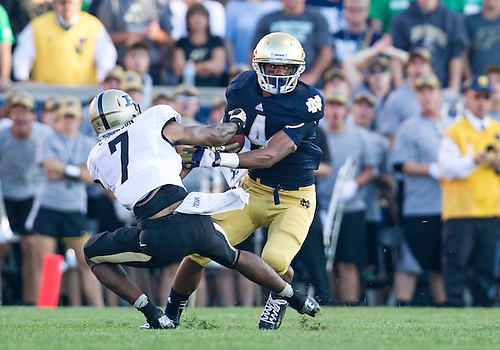 September 08, 2012:  Notre Dame Fighting Irish running back George Atkinson III (4) runs for yardage on the kick return as Purdue safety E.J. Johnson (7) attempts to make the tackle during NCAA Football game action between the Notre Dame Fighting Irish and the Purdue Boilermakers at Notre Dame Stadium in South Bend, Indiana.  Notre Dame defeated Purdue 20-17.
