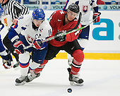 David Buc (Rouyn-Noranda Huskies - Slovakia) and Janick Steinmann (EV Zug - Switzerland) battle for the puck. The Suisse defeated Slovakia 2-1 in a 2007 World Juniors match on January 2, 2007, at FM Mattson Arena in Mora, Sweden.