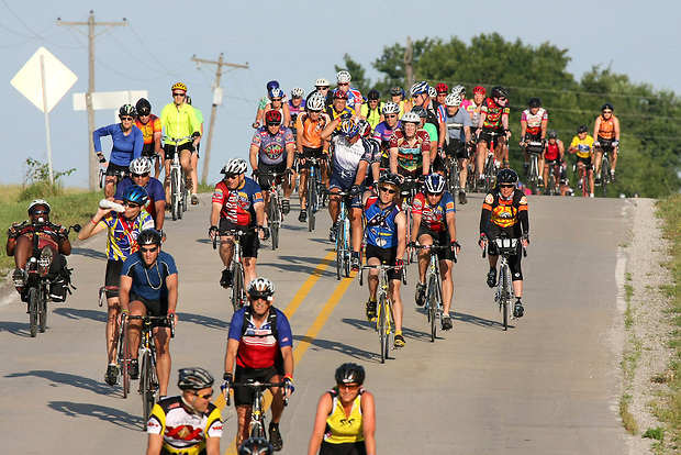 The crush of riders make their way east into Millerton, the day's first pass-through town Thursday morning on RAGBRAI XXXVII.