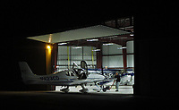 A Cirrus SR22 is towed out of Greg Goebel's hangar before dawn for an early morning flight, Petaluma Municipal Airport, Petaluma, Sonoma County, California