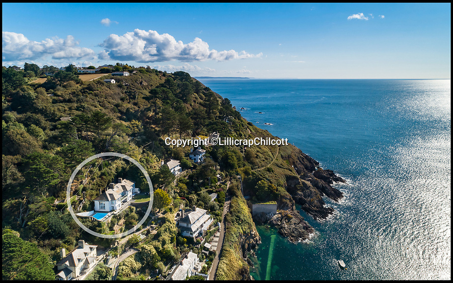 """BNPS.co.uk (01202 558833)<br /> Pic: LillicrapChilcott/BNPS<br /> <br /> Rooms with a view...Spectacular seaside home with breathtaking sea vistas.<br /> <br /> A spectacular Cornish coastal house with breathtaking panoramic views out to sea is on the market for £1.75m.<br /> <br /> Seaways is positioned on the hill overlooking the quaint fishing village of Polperro, where the owners can watch the boats come in and catch the sun all day.<br /> <br /> It was once the home of Doctor Zhivago actress Rita Tushingham, but has beeen completely renovated and updated by the current owners, who have added a swimming pool and hot tub.<br /> <br /> Estate agents Lillicrap Chilcott say no expense has been spared on the refurbishment and Seaways is the""""best house in Polperro""""."""