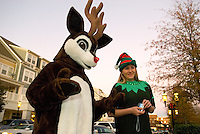 "An ""elf"" and ""reindeer"" wait for Santa's arrival during the annual Christmas tree lighting event at Birkdale Village in Huntersville, NC. Birkdale Village combines the best of shopping, dining, apartments and entertainment venues within a 52-acre mixed-use development."