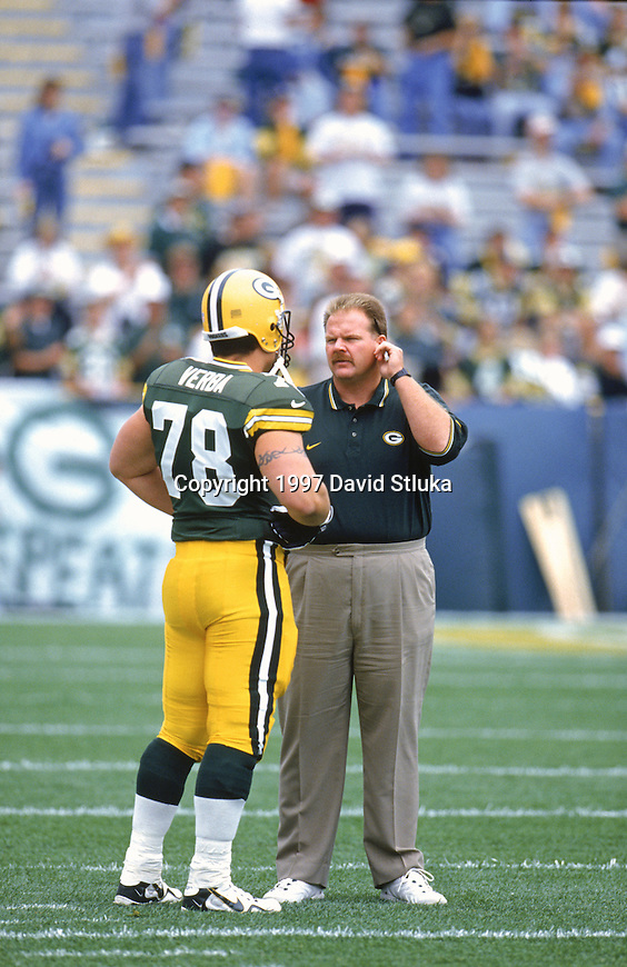 Green Bay Packers assistant coach Andy Reid during an NFL football game against the Miami Dolphins at Lambeau Field on September 14,1997 in Green Bay, Wisconsin. The Packers won 23-18.  (Photo by David Stluka)