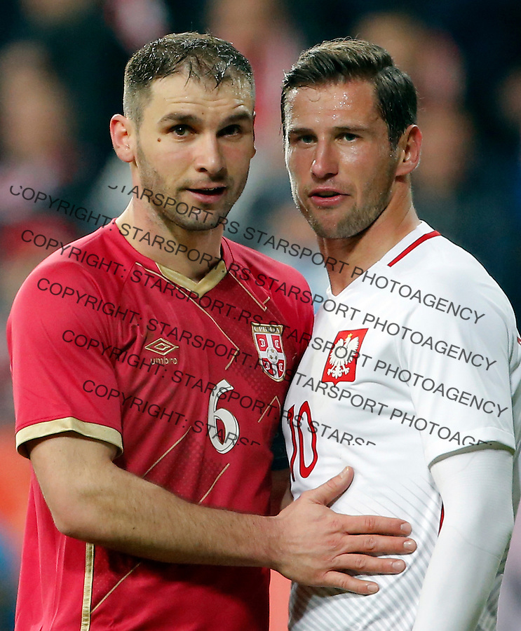 Branislav Ivanovic Grzegorz Krychowiak Poljska - Srbija prijateljska, Poland - Serbia friendly football match, March 23. 2016. Poznan  (credit image & photo: Pedja Milosavljevic / STARSPORT)