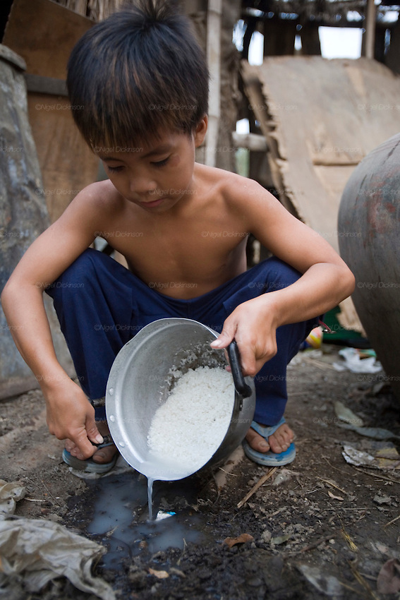 Sarak makes rice for dinner to help his mother with the household chores..Sarak is a young Khmer boy who comes from a peasant family, living in a small village in Battambang Province, in northwest Cambodia. He lives with his mother and father, brothers, sister, cousins and his aunts and uncles. they are a big family. Sarak loves to learn how to be an acrobat in the local circus school, and spends as much time as he can doing headstands and somersaults with his friends. To be honest, he is a bit of a scoundrel, and enjoys head butting the billy goat, but he makes up by feeding all the animals in his parents little farm. His mother works at the fishmarket in Battambang town, whilst his father sells icecreams. They don't have very much money, not even electricity, so he and his brothers and sisters do their homework under candlelight. He likes to take trips, with his mother and cousins, on his uncle's scooter.