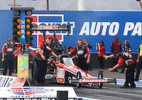 Feb 20, 2015; Chandler, AZ, USA; Crew members make final adjustments as another crew member guides NHRA top fuel driver Leah Pritchett during qualifying for the Carquest Nationals at Wild Horse Pass Motorsports Park. Mandatory Credit: Mark J. Rebilas-