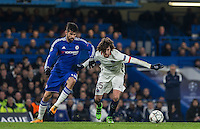 Diego Costa of Chelsea battles with Adrien Rabiot of Paris Saint-Germain during the UEFA Champions League Round of 16 2nd leg match between Chelsea and PSG at Stamford Bridge, London, England on 9 March 2016. Photo by Andy Rowland.