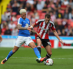 George Moncur of Peterborough Utd challenges Paul Coutts of Sheffield Utd during the League One match at Bramall Lane Stadium, Sheffield. Picture date: September 17th, 2016. Pic Simon Bellis/Sportimage
