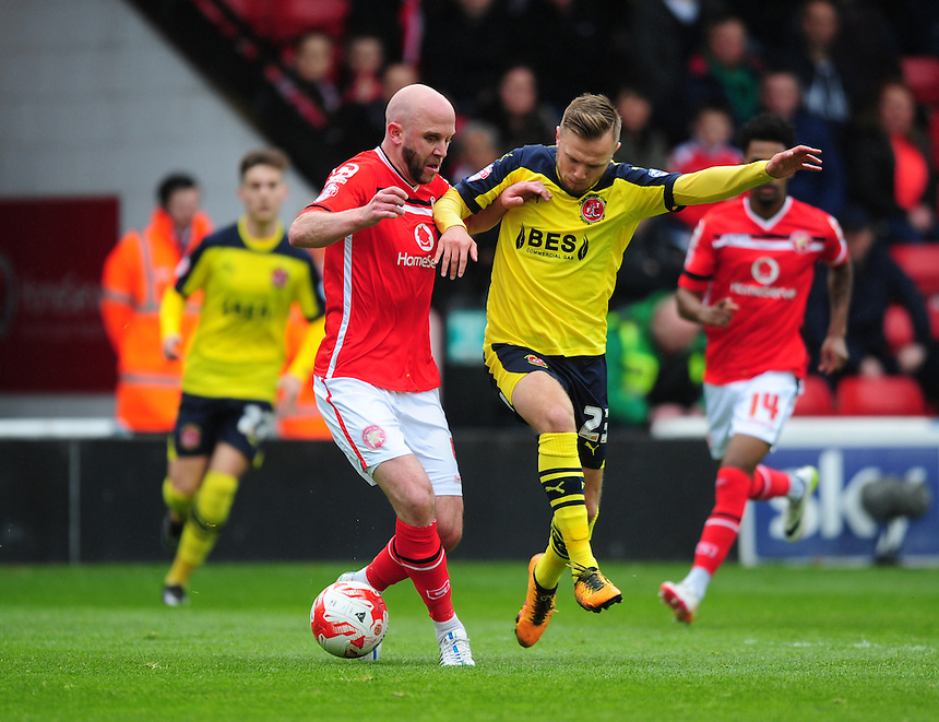 Fleetwood Town's David Ball vies for possession with Walsall's James O'Connor<br /> <br /> Photographer Chris Vaughan/CameraSport<br /> <br /> Football - The Football League Sky Bet League One - Walsall v Fleetwood Town - Monday 2nd May 2016 - Banks's Stadium - Walsall   <br /> <br /> &copy; CameraSport - 43 Linden Ave. Countesthorpe. Leicester. England. LE8 5PG - Tel: +44 (0) 116 277 4147 - admin@camerasport.com - www.camerasport.com