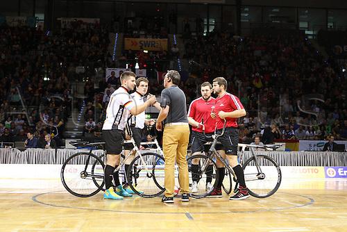 03.12.2016. Stuttgart, Germany. UCI Hallenradsport Radball Group A, Austria versus Germany.<br /> Gerhard Mladye Bernd Mladye Germany BDR with Markus  and Patrick Schnetzer team Austria before the Kick-off