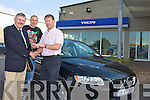KEYS: Kerry manager Jack O'Connor gets the key of a brand new Volvo from Billy Naughton, Mile Height, Tralee, on Monday as Kerry footballer Kieran Donaghy looks on.
