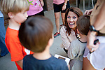 GOP Presidential candidate Rep. Michele Bachmann speaks with supporters during at a campaign stop at Palmer's Deli in Des Moines, Iowa, July 20, 2011.