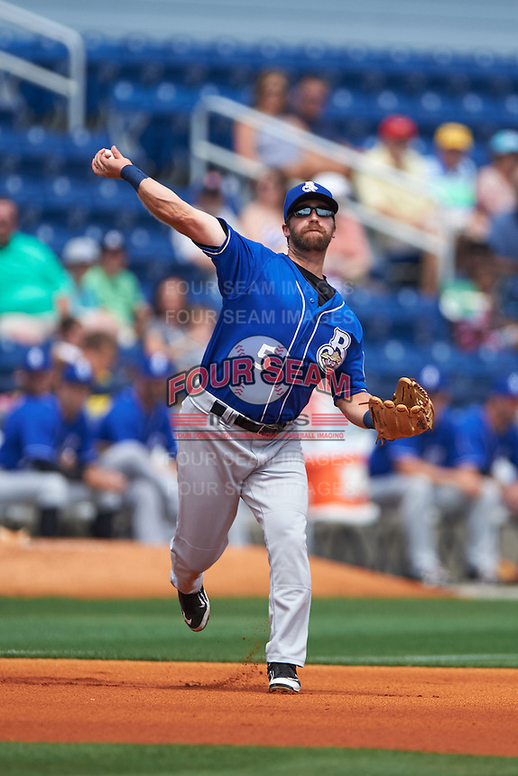 Biloxi Shuckers third baseman Taylor Green (5) throws to first during the first game of a double header against the Pensacola Blue Wahoos on April 26, 2015 at Pensacola Bayfront Stadium in Pensacola, Florida.  Biloxi defeated Pensacola 2-1.  (Mike Janes/Four Seam Images)