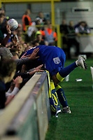 AFC Wimbledon's Andy Barchan ends up in the crowd during the Sky Bet League 1 match between AFC Wimbledon and MK Dons at the Cherry Red Records Stadium, Kingston, England on 22 September 2017. Photo by Carlton Myrie / PRiME Media Images.
