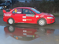 Craig McMiken - Craig Wallace in a Mitsubishi Lancer Evolution 9 at the Noise Test which took place at the Tulloch Stadium, Inverness for the 2014 Arnold Clark/Thistle Hotel Snowman Rally supported by Highland Office Equipment, part of the Capital Document Solutions which was organised by Highland Car Club and based in Inverness on 22.2.14; Round 1 of the 2014 RAC MSA Scottish Rally Championship sponsored by ARR Craib Transport Limited.