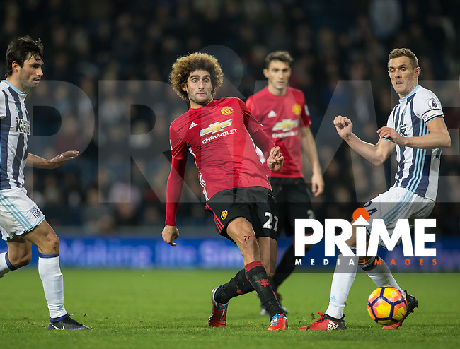Marouane Fellaini of Manchester United plays a pass past Darren Fletcher of West Bromwich Albion during the EPL - Premier League match between West Bromwich Albion and Manchester United at The Hawthorns, West Bromwich, England on 17 December 2016. Photo by Andy Rowland / PRiME Media Images.