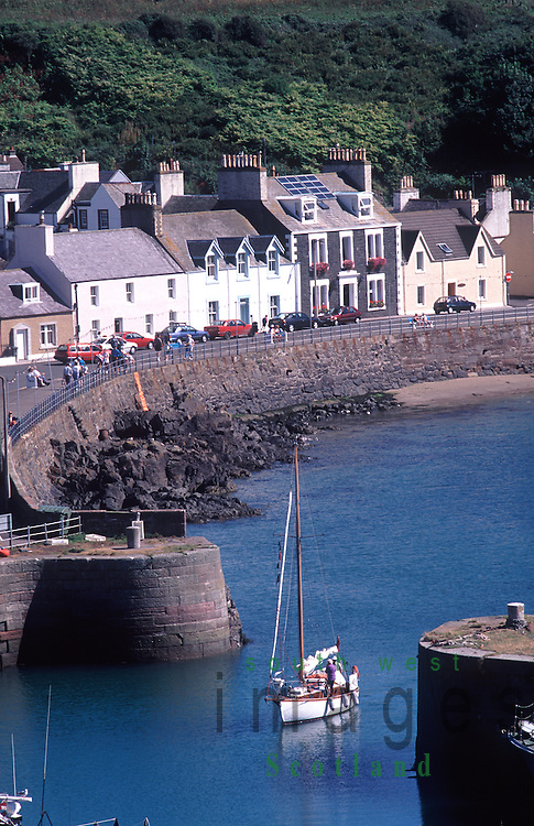 Yacht entering Portpatrick Harbour in the Rhins of Galloway Scotland UK