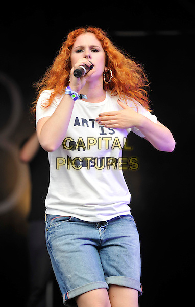 "KATY B (Kathleen ""Katie"" Brien).Camp Bestival at Lulworth Castle & Park, Dorset, England..July 31st 2011.stage concert live gig performance music half length jean denim shorts white t-shirt slogan art is for mobsters hand arm singing.CAP/ROS.©Steve Ross/Capital Pictures"