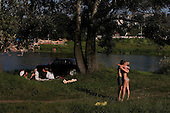 Izyum, Ukraine.July 31, 2005 ..Life by the Siverskiy Donets river. .......