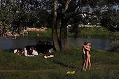Izyum, Ukraine.July 31, 2005 ..Life by the Siverskiy Donets river. .......