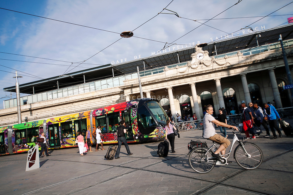 A tram on line 3 passes the main city railway station, Montpellier, France, 13 July 2012. The tram cars were designed by Christian Lacroix and put into service earlier in the year.