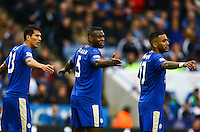 Leonardo Ulloa, Wes Morgan and Danny Simpson of Leicester City line up at a free kick during the Barclays Premier League match between Leicester City and Swansea City played at The King Power Stadium, Leicester on 24th April 2016