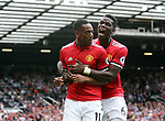 Manchester United's Paul Pogba celebrates with goalscorer Anthony Martial during the premier league match at Old Trafford Stadium, Manchester. Picture date 13th August 2017. Picture credit should read: David Klein/Sportimage