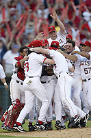 Los Angeles Angels celebrate their first ever playoff series win after beating the New York Yankees during the 2002 MLB season Division Playoffs at Angel Stadium, in Anaheim, California. (Larry Goren/Four Seam Images)