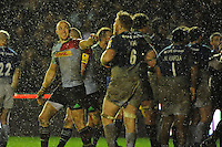 Mike Brown of Harlequins jests with Jackson Wray of Saracens after the winning try in the final minutes of the match during the Premiership Rugby match between Harlequins and Saracens - 09/01/2016 - Twickenham Stoop, London<br /> Mandatory Credit: Rob Munro/Stewart Communications