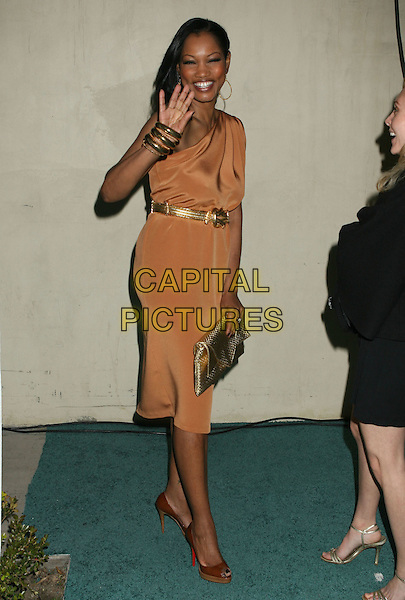 GARCELLE BEAUVAIS-NILON.InStyle and the Recording Academy Celebrate Grammy Salute to Fashion held at Boulevard 3,.Hollywood, California, USA,.07 February 2008..full length hand waving peach dress gold belt.CAP/ADM/RE.?Russ Elliott/Admedia/Capital PIctures