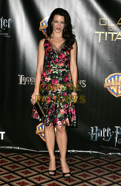 KRISTIN DAVIS.Warner Brothers ShoWest Presentation at the Paris Resort Hotel and Casino, Las Vegas, Nevada, USA..March 18th, 2010.full length pink black floral print dress sleeveless clutch bag open toe shoes .CAP/ADM/MJT.© MJT/AdMedia/Capital Pictures.