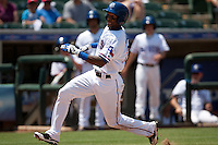 Round Rock Express outfielder Julio Borbon #20 slides home during the Pacific Coast League baseball game against the Memphis Redbirds on May 6, 2012 at The Dell Diamond in Round Rock, Texas. The Express defeated the Redbirds 5-1. (Andrew Woolley/Four Seam Images)