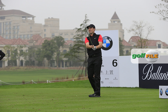 Ross Fisher (ENG) tees off the 6th tee during Saturay's Round 3 of the 2014 BMW Masters held at Lake Malaren, Shanghai, China. 1st November 2014.<br /> Picture: Eoin Clarke www.golffile.ie
