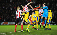 Chester's Alex Lynch punches the ball clear under pressure from Lincoln City's Sean Raggett<br /> <br /> Photographer Chris Vaughan/CameraSport<br /> <br /> Vanarama National League - Lincoln City v Chester - Tuesday 11th April 2017 - Sincil Bank - Lincoln<br /> <br /> World Copyright &copy; 2017 CameraSport. All rights reserved. 43 Linden Ave. Countesthorpe. Leicester. England. LE8 5PG - Tel: +44 (0) 116 277 4147 - admin@camerasport.com - www.camerasport.com