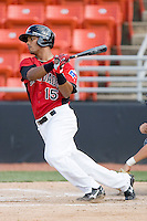 Miguel Velazquez #15 of the Hickory Crawdads follows through on his swing against the Rome Braves at  L.P. Frans Stadium May 23, 2010, in Hickory, North Carolina.  The Rome Braves defeated the Hickory Crawdads 5-1.  Photo by Brian Westerholt / Four Seam Images