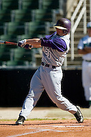 James Madison right fielder Kellen Kulbacki (21) follows through on his swing versus Charlotte at Fieldcrest Cannon Stadium in Kannapolis, NC, Friday, March 2, 2007.  The Charlotte 49'ers defeated the James Madison Dukes 16-7.